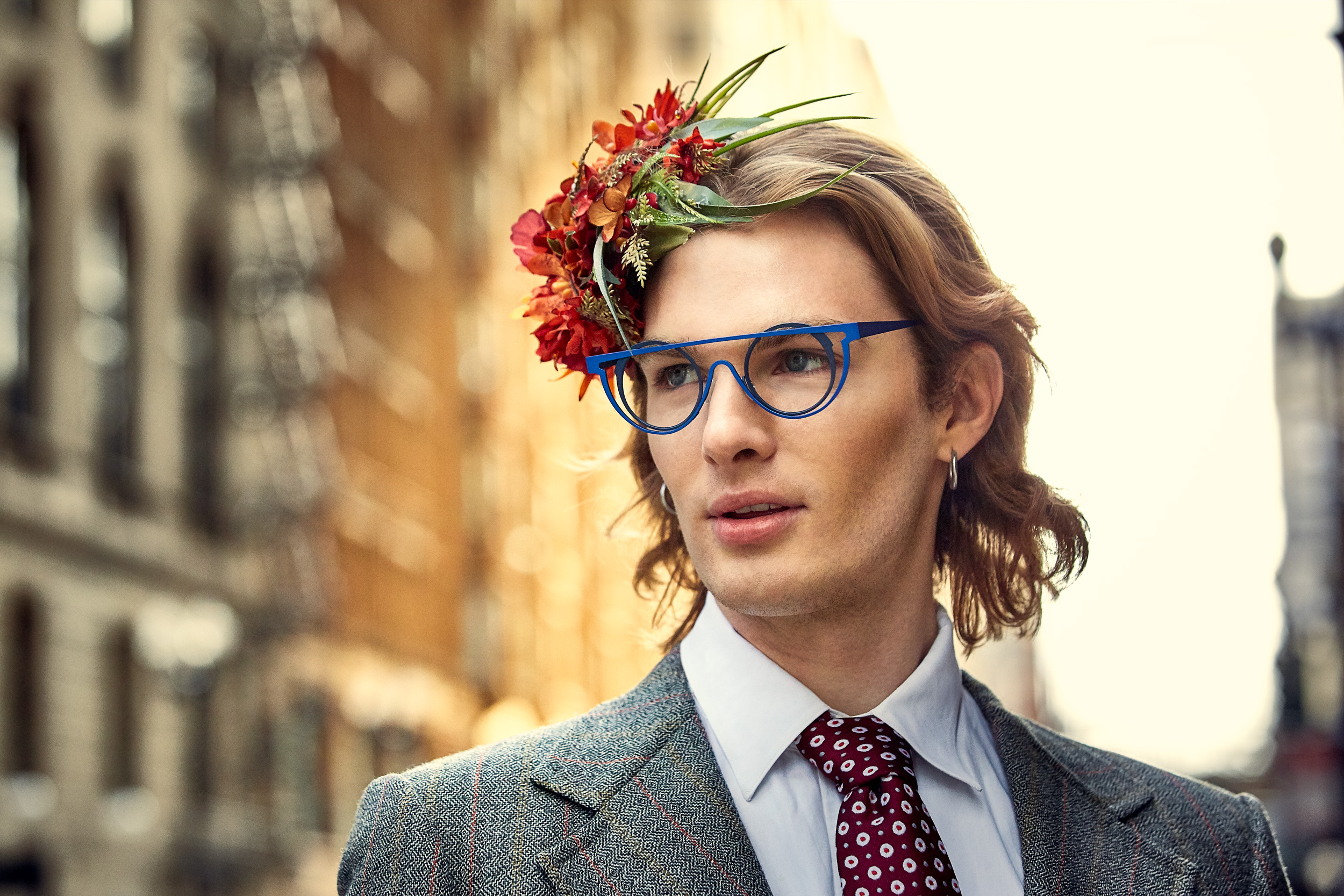 Portrait of man wearing designer glasses and a fascinator photographed by Dave Rentauskas on the streets of Chicago