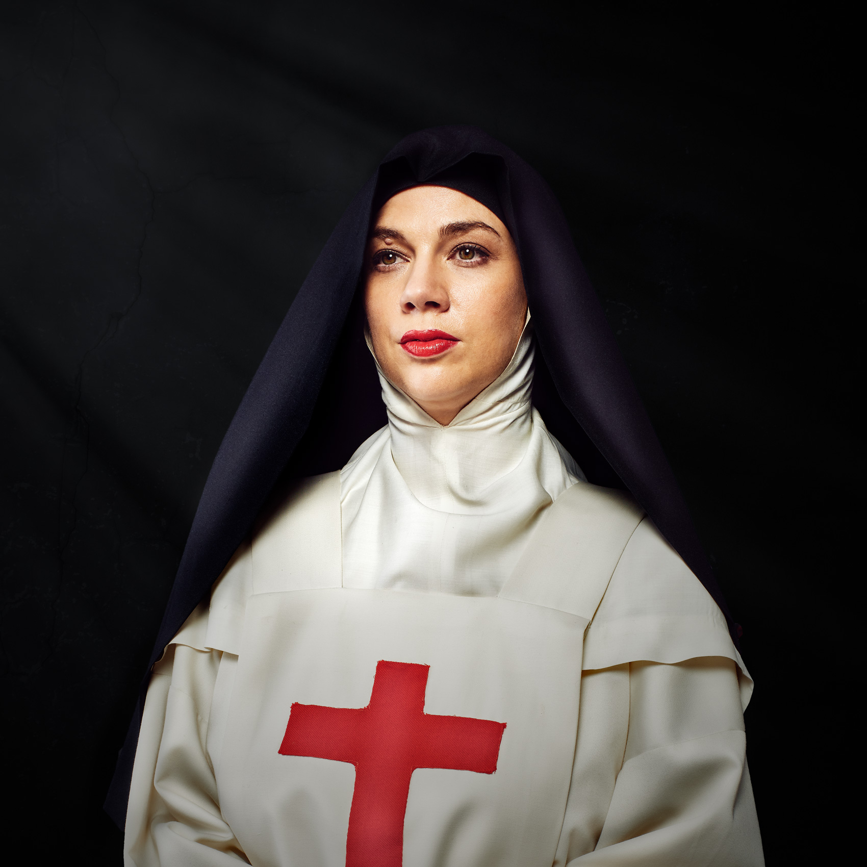 Portrait of a nun on a black background photographed by Dave Rentauskas