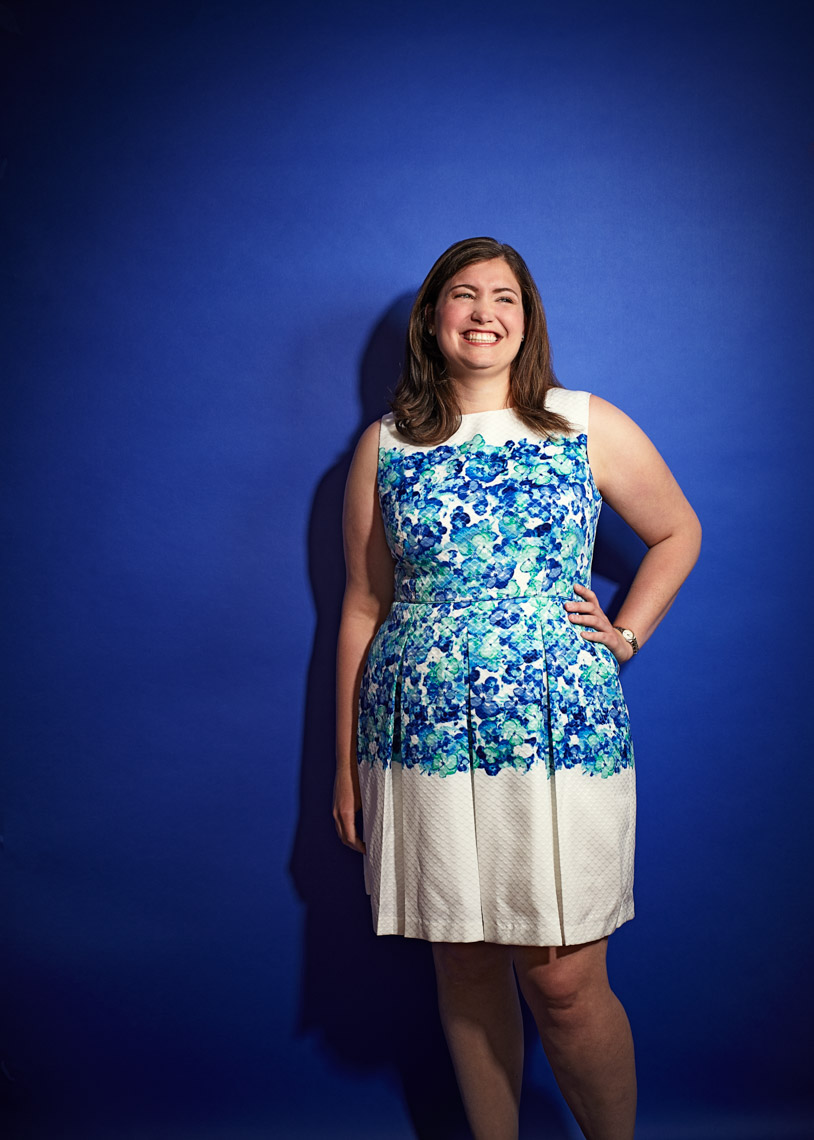 Portrait of Jeopardy winner Julia Collins on a blue background photographed by Dave Rentauskas